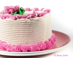 Food white cake with pink icing
