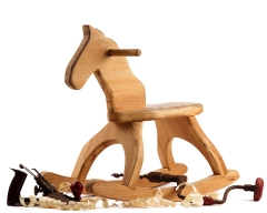 Wooden horse with teh tool sused to craft it